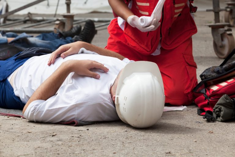 man being attended to by paramedic